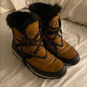 Black and Tan Sorel Boots